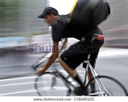 Shipping with bicycle in the city, intentional motion blur - stock photo
