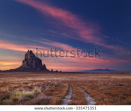 Shiprock, the great volcanic rock mountain in desert plane of New Mexico, USA - stock photo