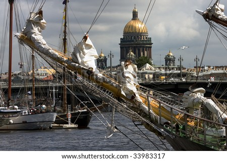 Ships at Neva river with St.Isaak cathedral, St.Petersburg, Russia - stock photo