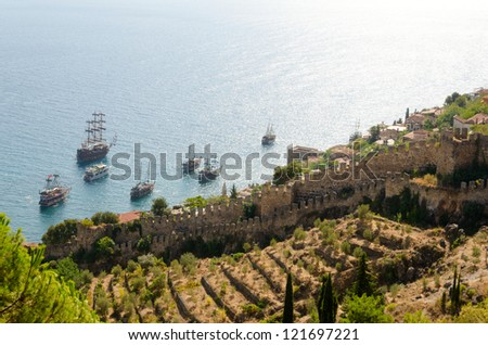 Ships at sea near the fortress of the day - stock photo