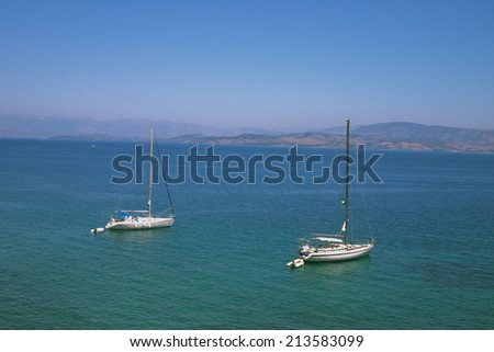 ships at sea off the coast of Corfu - stock photo