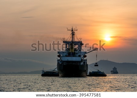 Ships at Sunset: Work Hard, Play Later - stock photo