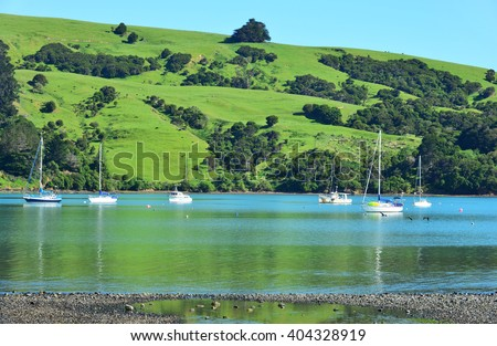 Ships berthed in Akaroa, New Zealand - stock photo