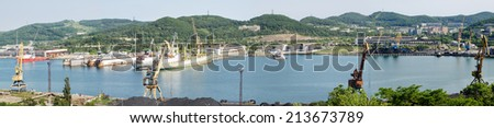 Ships during construction works in a shipyard on a floating dock. - stock photo
