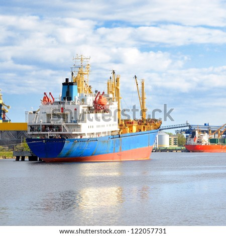 ships in a cargo port. Ventspils, Latvia - stock photo