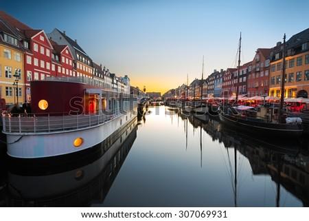 Ships in Nyhavn at sunset, Copenhagen, Denmark - stock photo