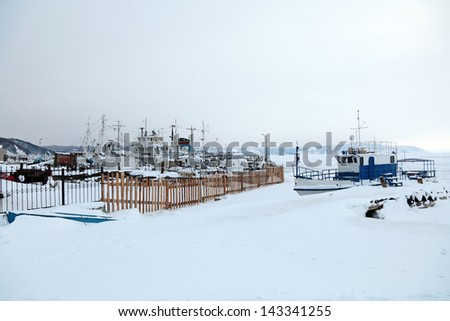 Ships in the winter mooring on lake Baikal, Siberia, Russia - stock photo