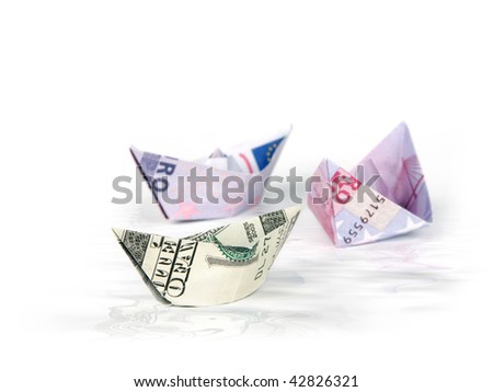 Ships made of money in water - stock photo