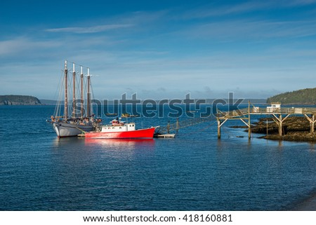 Ships moored in Bar Harbor Maine, USA. Bar Harbor is home to the largest parts of Acadia National Park.  - stock photo