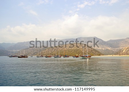 ships near Mediterranean coastline in neighborhood to Myra in Antalya region in Turkey - stock photo