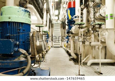 Ships valves, main engine - engineering interior - stock photo