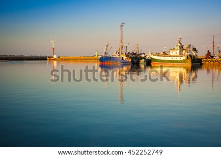 Ships view in the Wladyslawowo port during sunset - stock photo