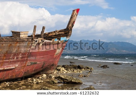 Shipwreck detail during a low tide time in shoreline - stock photo