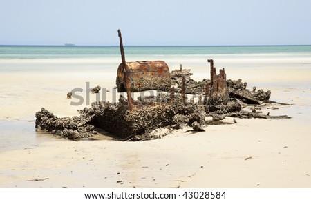 shipwreck of steam ship on beach Moreton Island Queensland Australia - stock photo