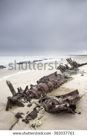 Shipwreck of Zelia of Hangana on Skeleton Coast of Namibia. - stock photo