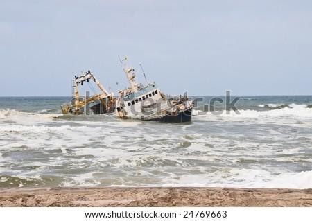 Shipwreck on beach, Skeleton Coast, Namibia - stock photo