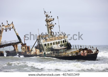 Shipwreck with cormorants on Skeleton Coast near Swakopmund, Namibia, Africa.