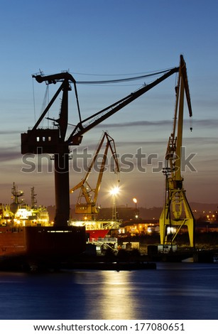 Shipyard at dusk.Cranes in the port. - stock photo
