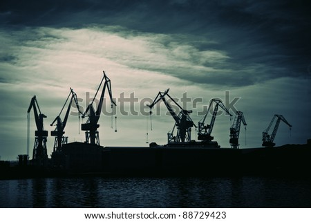 Shipyard cranes , retro style toned photo