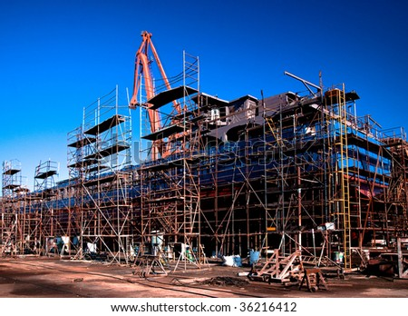 Shipyard - ship in a dry dock - stock photo