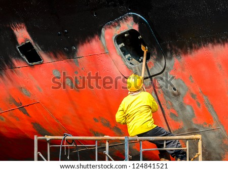 shipyard worker to clean ship - stock photo
