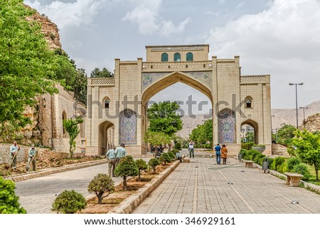 SHIRAZ, IRAN - MAY 3, 2015: People walking around the Qur'an Gate. Travelers passing underneath the gates were believed to receive the blessing of the Holy Book as they began their journey.