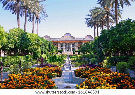 SHIRAZ, IRAN  OCTOBER 9: Naranjestan garden on October 9, 2013 in Shiraz, Iran. Naranjestan garden is famous for the opulently decorated pavilion that was built between 1879 and 1886,. - stock photo