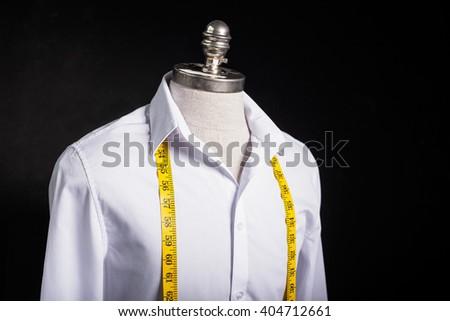 Shirt and measurement tape - stock photo