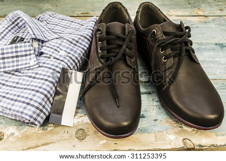 shirt and shoes on wooden boards