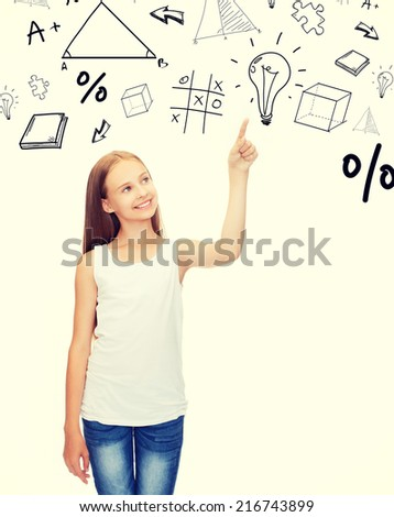 shirt design concept - smiling teenage girl in blank white shirt pointing to something or pressing imaginary button - stock photo
