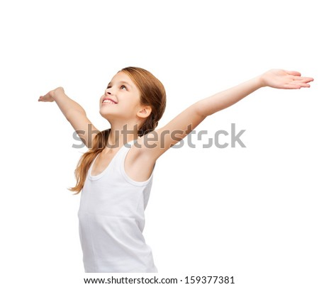 shirt design, happiness, freedom, future concept - smiling teenage girl in blank white shirt with raised hands