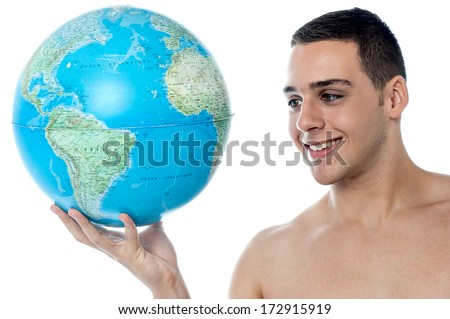 Shirtless guy holding a globe on a white background
