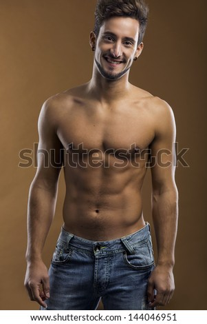 Shirtless male model smiling to the camera - stock photo