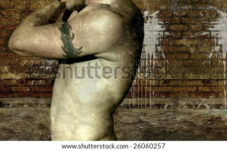 Shirtless male torso with arm showing tribal tattoo against a grunge background