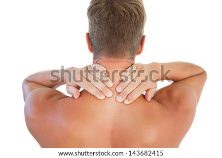 Shirtless man having a neck ache on white background