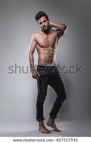 Shirtless man posing seriously. Studio - stock photo