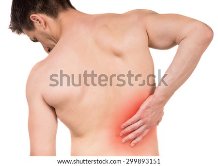 Shirtless man touching his back against write isolated background. Back view. - stock photo