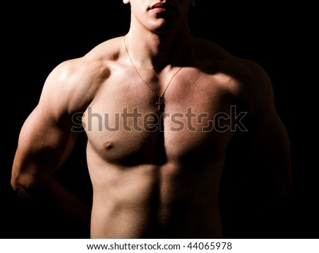Shirtless man with muscular sexy body over black - stock photo