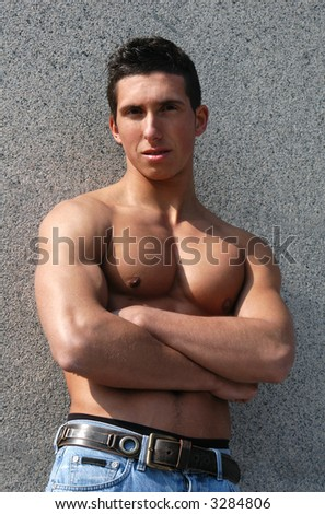 Shirtless muscular male model in front of the stonewall