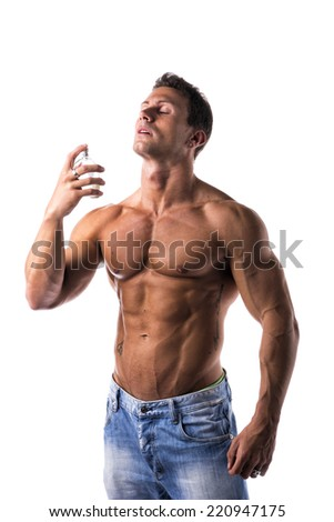 Shirtless muscular male model spraying cologne on white background, eyes closed