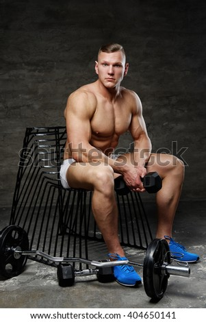 Shirtless muscular man in a blue shoes - stock photo
