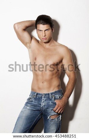 Shirtless muscular man in jeans