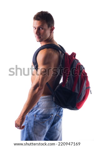 Shirtless muscular young man with rucksack on his back looking at camera, isolated - stock photo