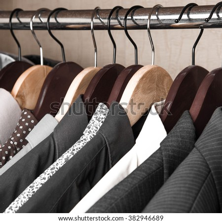 shirts and jackets in the wardrobe isolated closeup