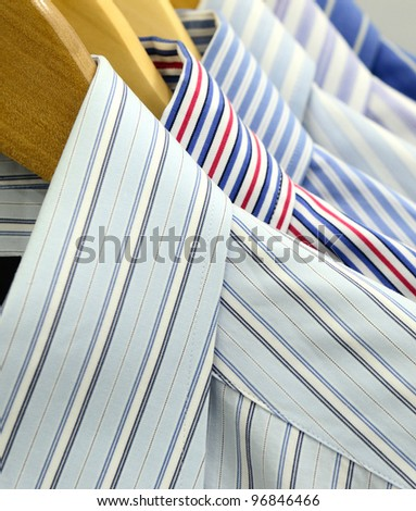 Shirts on Wooden Hangers - stock photo