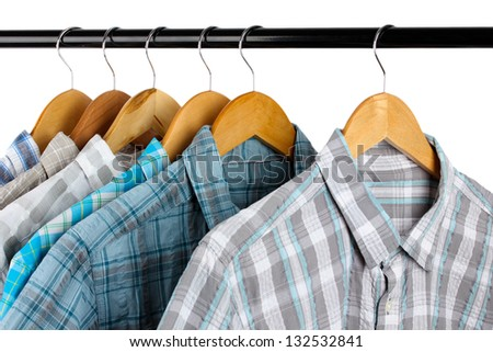 Shirts with ties on wooden hangers isolated on white