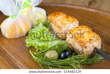 Shish kebab from a salmon with black and green olives and lemon - stock photo