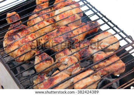 shish kebab on skewers over charcoal in the grill