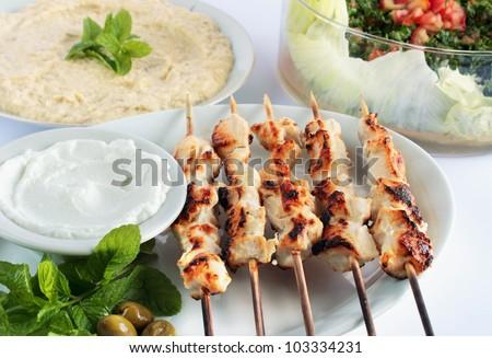 Shish taouk - Chicken shish kebab on white platter - stock photo
