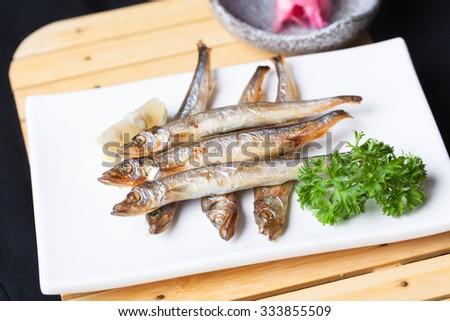shishamo fried in dish in the restaurant - stock photo